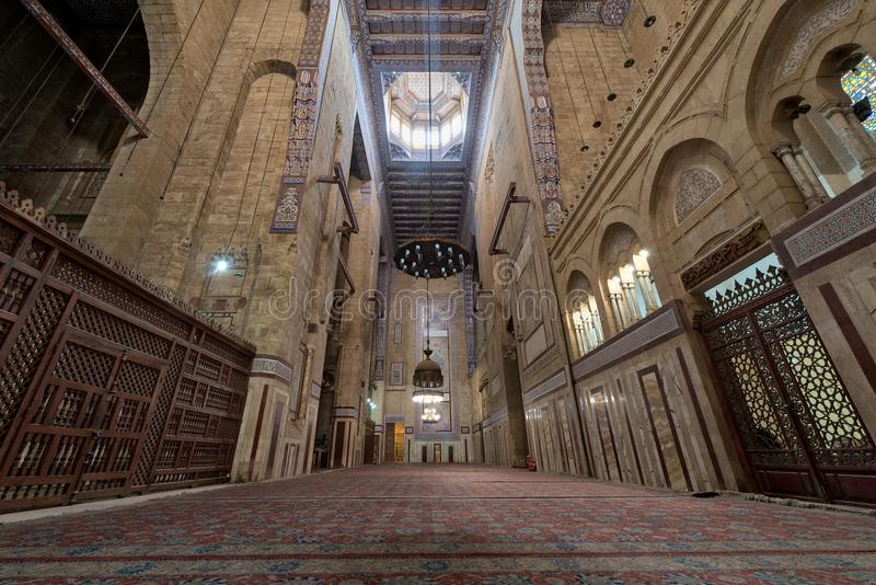 Interior of al Refai mosque with old decorated bricks stone wall, colored marble decorations, wooden ornate ceiling, Cairo, Egypt stock photos