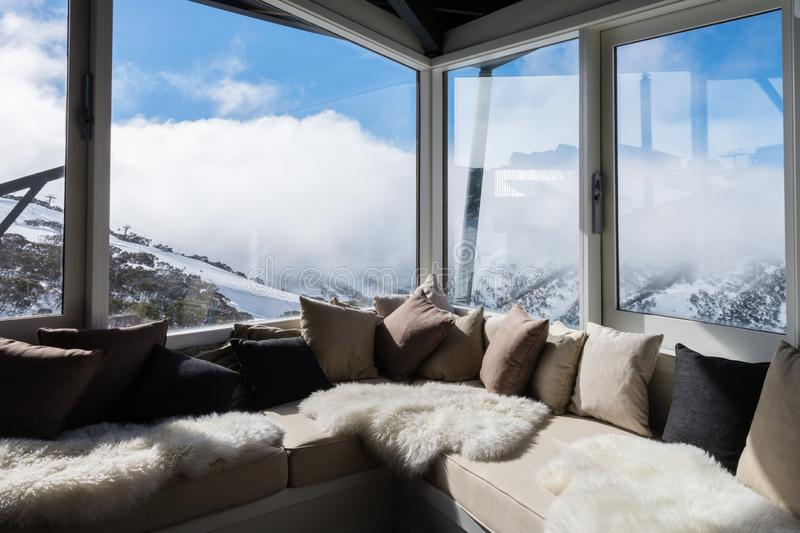 Interior of alpine chalet looking over mountains royalty free stock image