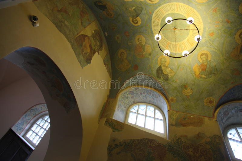 Interior, altar, icons, frescoes, baptismal font, in the old russian traditional orthodox church. Detail of the religious frescoes on a wall of the ruins of a stock photography