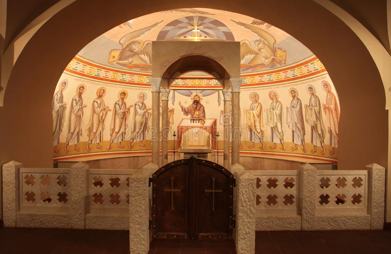Interior, altar, icons, frescoes, baptismal font, in the old russian traditional orthodox church. Detail of the religious frescoes on a wall of the ruins of a royalty free stock images