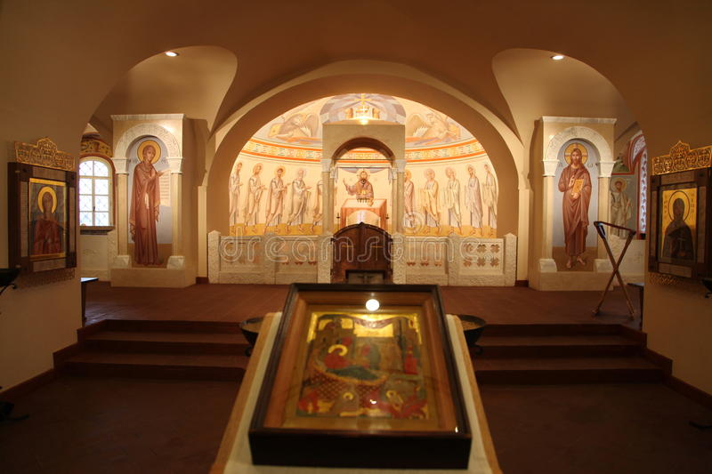 Interior, altar, icons, frescoes, baptismal font, in the old russian traditional orthodox church. Detail of the religious frescoes on a wall of the ruins of a stock images