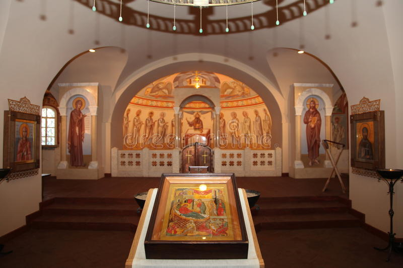 Interior, altar, icons, frescoes, baptismal font, in the old russian traditional orthodox church. Detail of the religious frescoes on a wall of the ruins of a royalty free stock photography