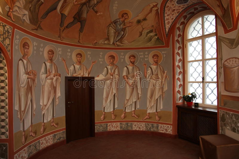 Interior, altar, icons, frescoes, baptismal font, in the old russian traditional orthodox church. Detail of the religious frescoes on a wall of the ruins of a royalty free stock photos
