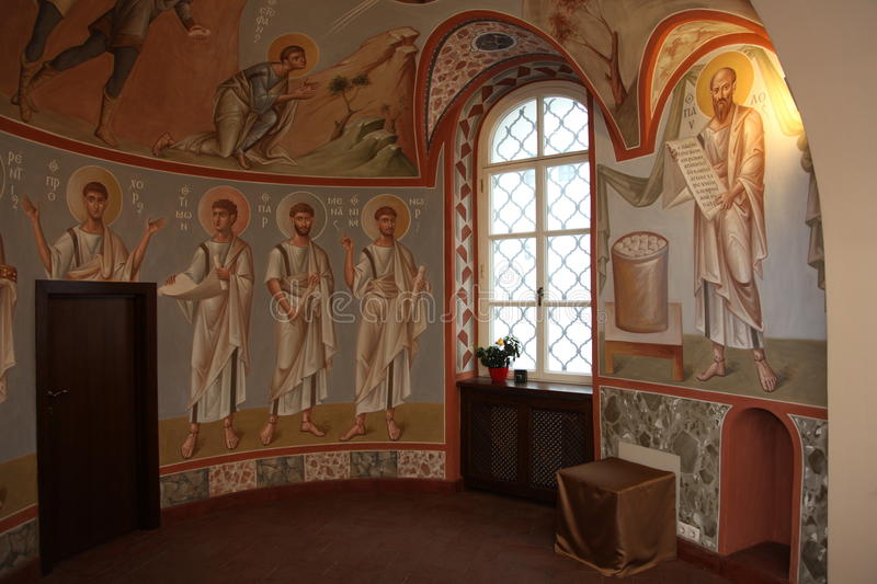 Interior, altar, icons, frescoes, baptismal font, in the old russian traditional orthodox church. Detail of the religious frescoes on a wall of the ruins of a stock photos