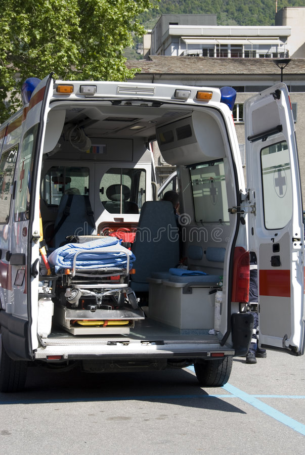 Interior ambulance. Back of an ambulance with opened doors. Emergency equipment and devices visible stock images
