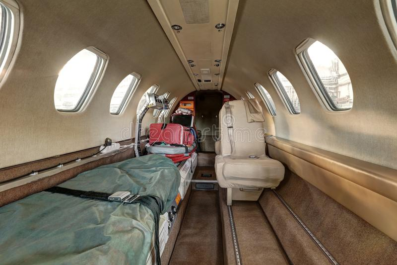 Interior of the ambulance airplane with pair of stretchers. Empty interior of the ambulance airplane with pair of stretchers stock photos
