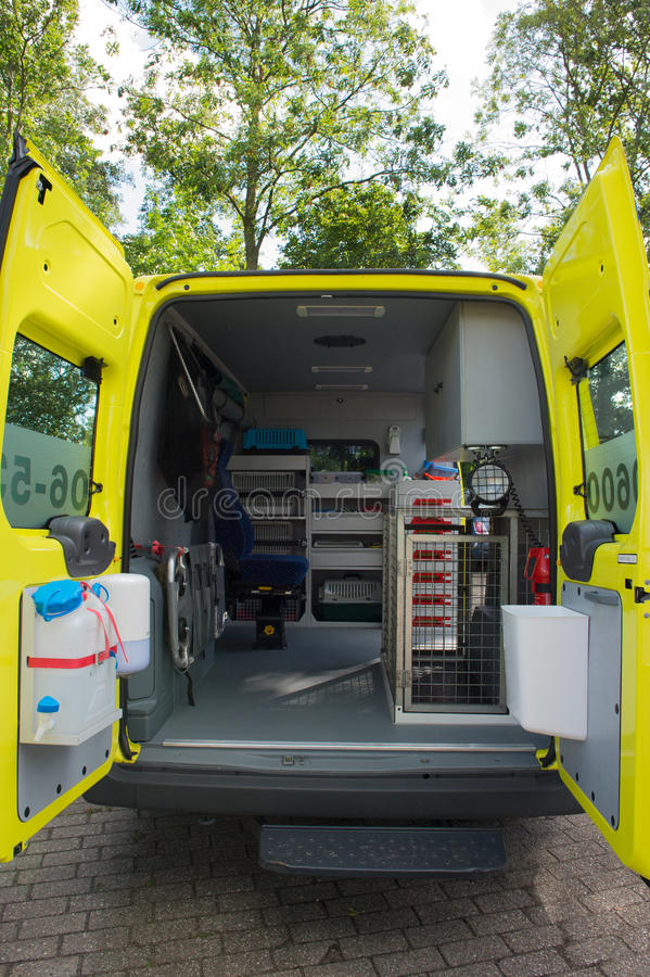 Interior ambulance for animals. With cages and chair stock photos
