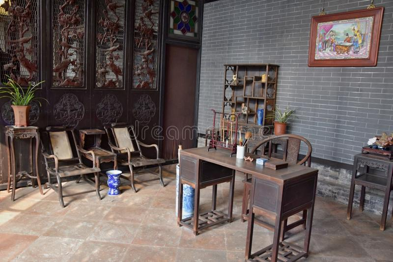 Interior with antique wooden furniture. Traditional room of wealthy chinese family royalty free stock images
