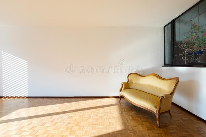 Interior of apartments, empty room with divan royalty free stock images