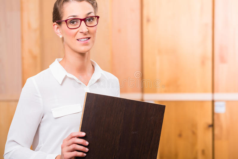 Interior architect choosing parquet wood floor stock image