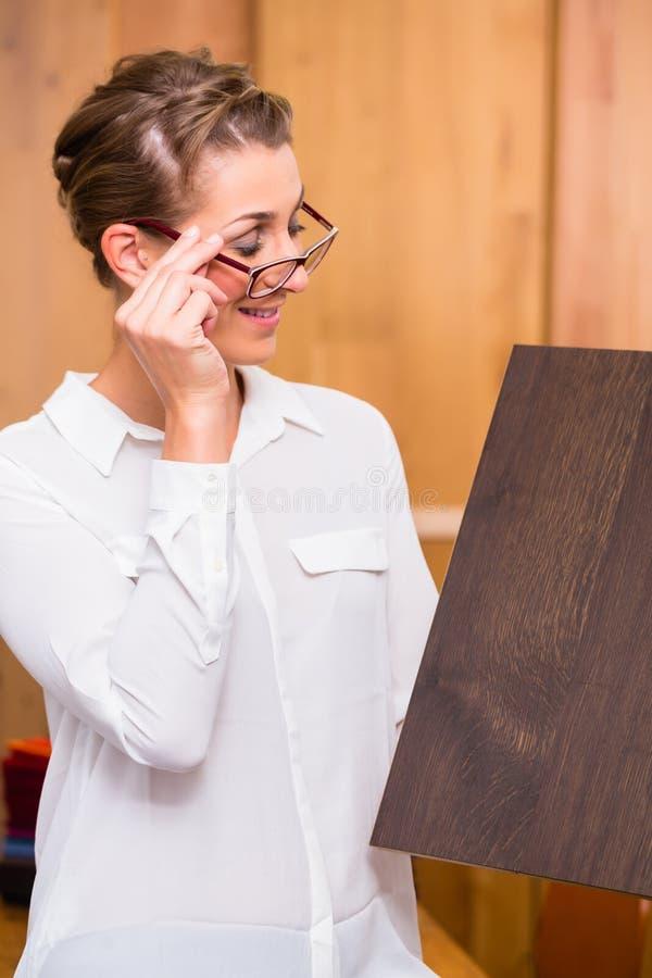 Interior architect choosing parquet wood floor stock photos