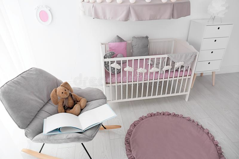 Interior of baby room with crib. Interior of baby room with comfortable crib stock photography