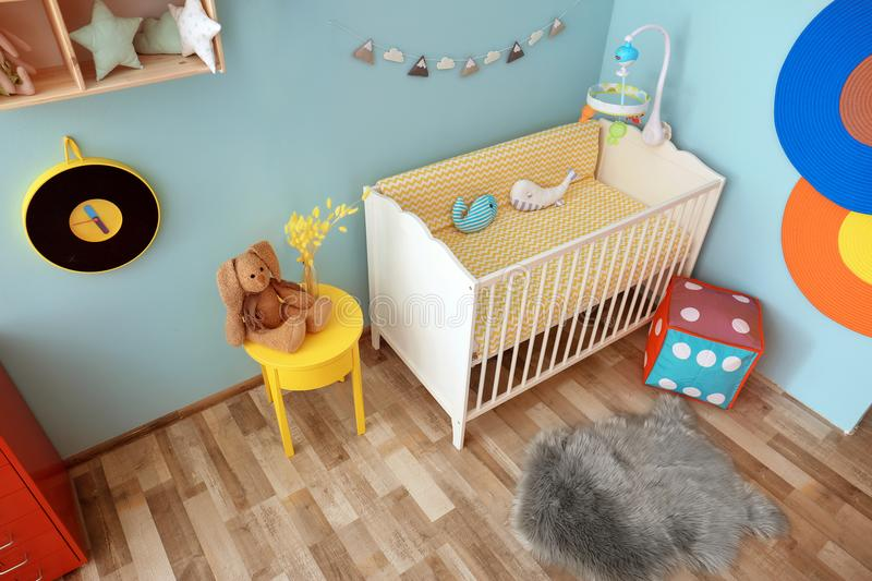Interior of baby room with crib. Interior of baby room with comfortable crib stock photo