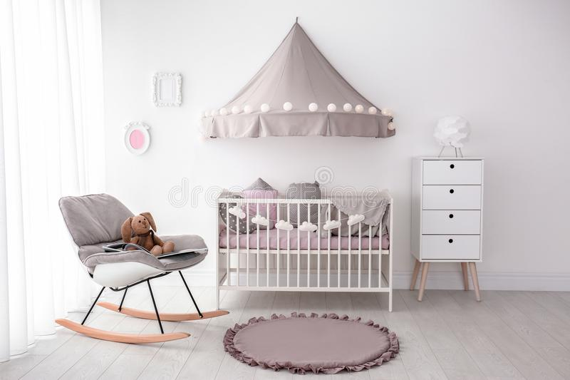 Interior of baby room with crib. Interior of baby room with comfortable crib stock images
