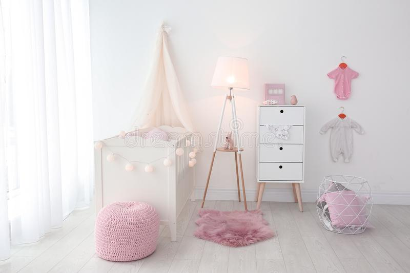 Interior of baby room with crib. Interior of baby room with comfortable crib stock image