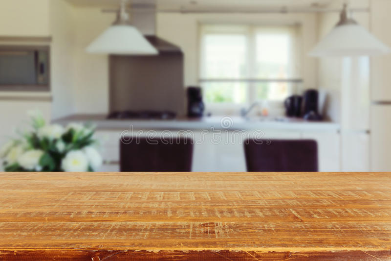 Interior background with empty kitchen table. Interior blur background with empty kitchen table