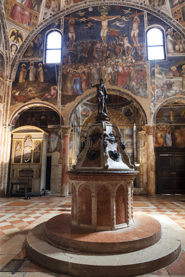 The interior of the baptistery dedicated to Saint John the Baptist with a baptismal font in the center. Padua. Italy royalty free stock photo