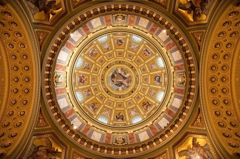 Interior of basilica. Interior of large heavily decorated basilica royalty free stock photos