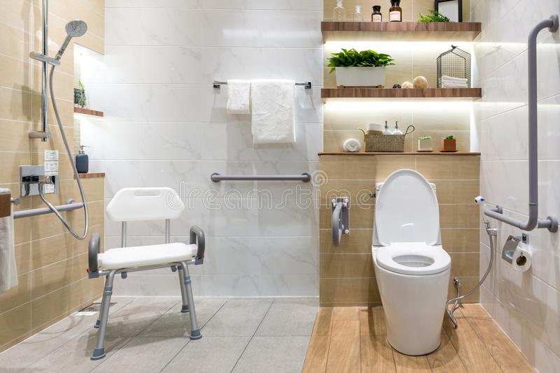 Interior of bathroom for the disabled or elderly people. Handrail for disabled and elderly people in the bathroom royalty free stock photo