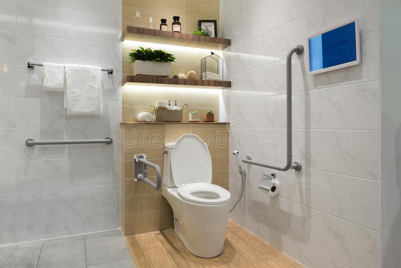 Interior of bathroom for the disabled or elderly people. =. Interior of bathroom for the disabled or elderly people. Handrail for disabled and elderly people in stock photography