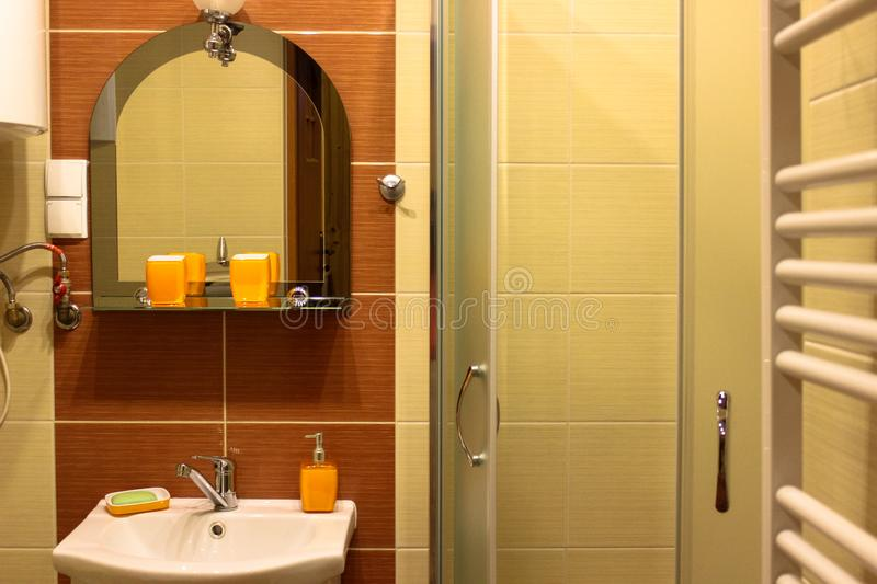 Interior of the bathroom. Mirror, washbasin, soap dish, shower stock photos
