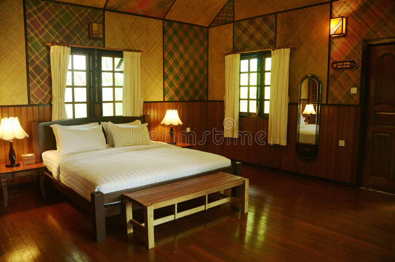 Interior bedroom chalet five star resort Borneo, Malaysia, Asia. Beautiful roomy large interior design five star bedroom suite of a chalet in Borneo, Malaysia stock photography