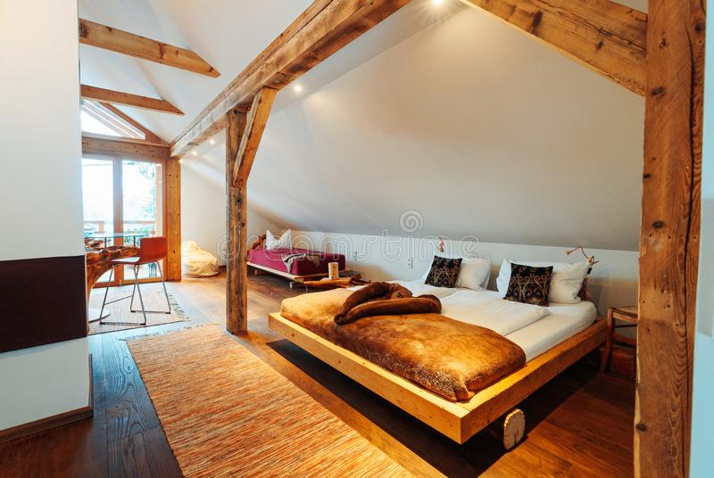Interior of bedroom Modern wood design of bed. Interior with bedroom. Modern wood design of bed. Wooden furniture of room. Home decor. House apartment. Cozy royalty free stock photography