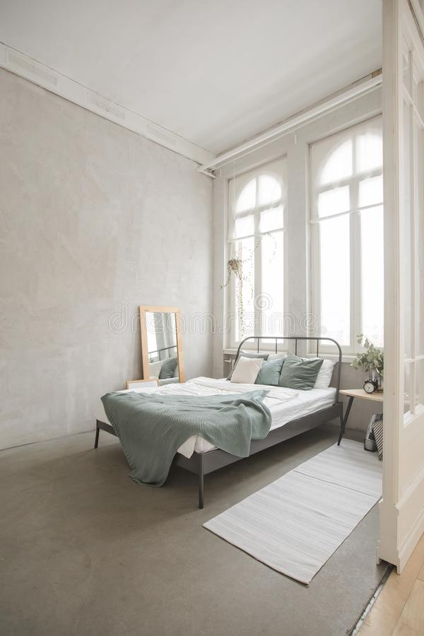 Interior of white and gray cozy bedroom royalty free stock photos