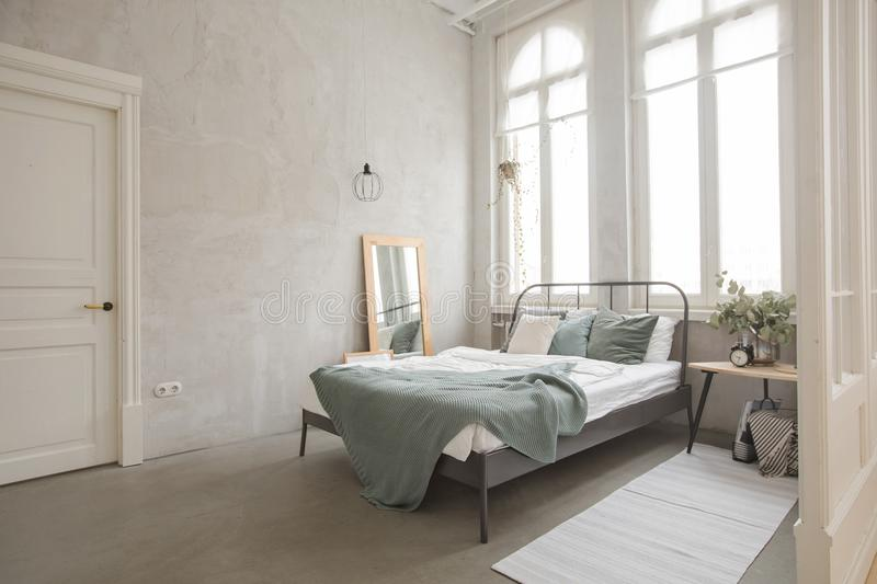 Interior of white and gray cozy bedroom royalty free stock photography
