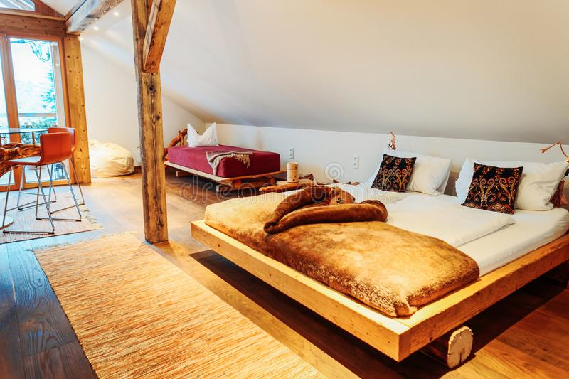 Interior of bedroom wood Modern design of bed. Interior of bedroom. Modern wood design of bed. Wooden furniture of room. Home decor. House apartment. Cozy style royalty free stock image