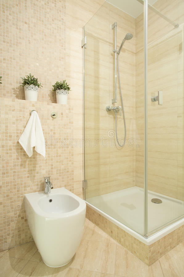 Interior of beige bathroom. In the house stock photography