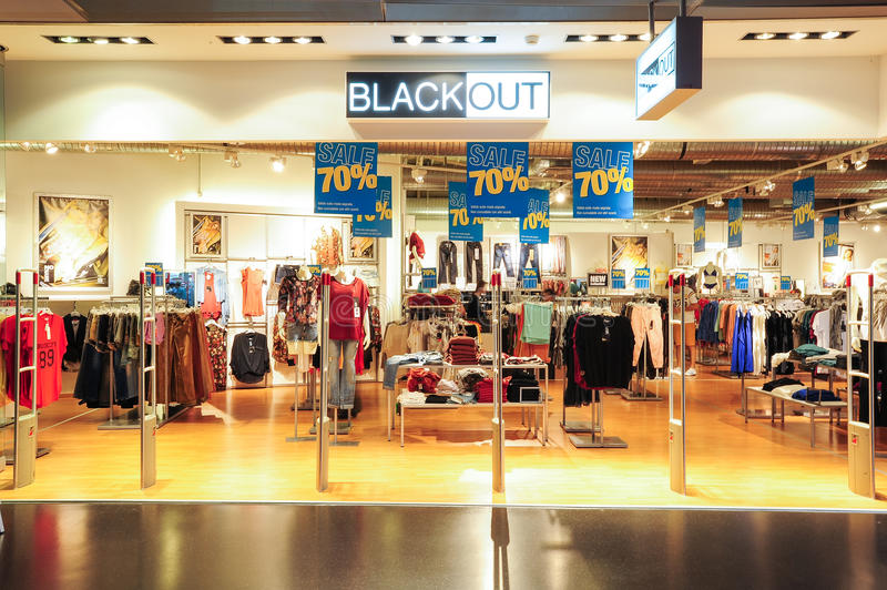 Interior of Black Out fashion clothes store stock photography
