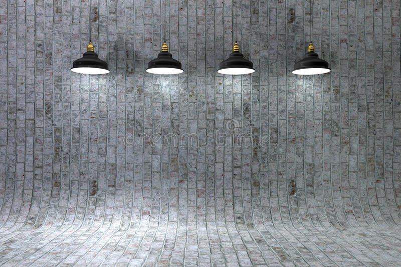 Interior brick wall illuminated by lamps above. Blank brick wall with place for text illuminated by lamps above