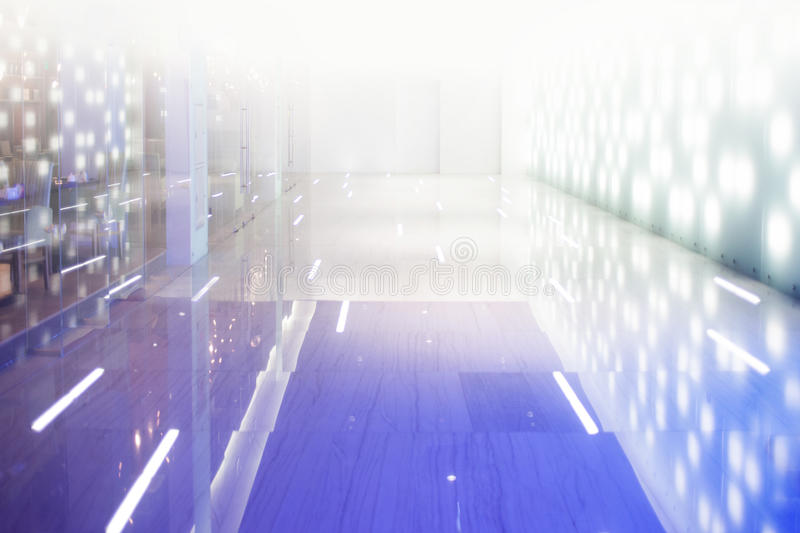 Interior is brightly lit shopping Mall, a glossy. Floor, perspective stock photo
