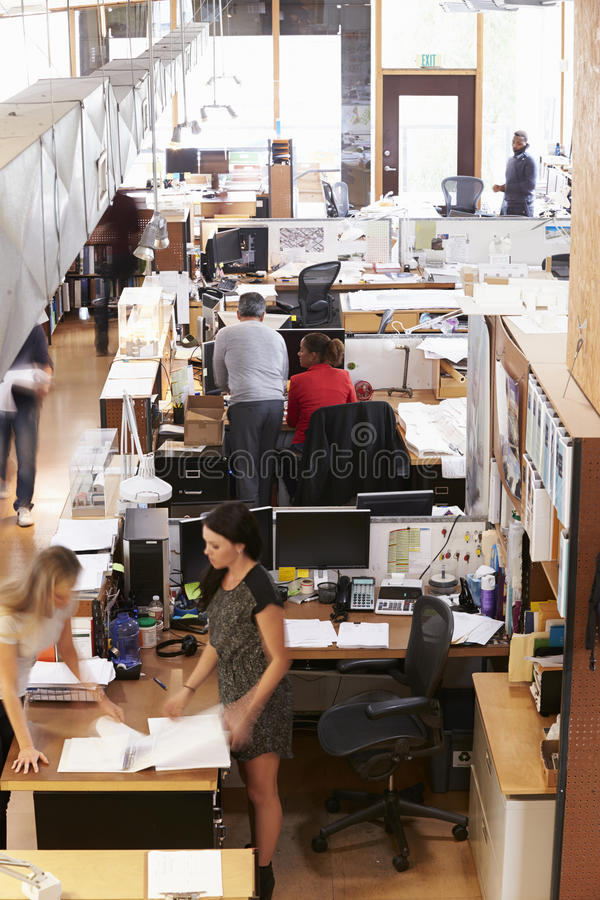 Interior Of Busy Architect's Office With Staff Working royalty free stock image