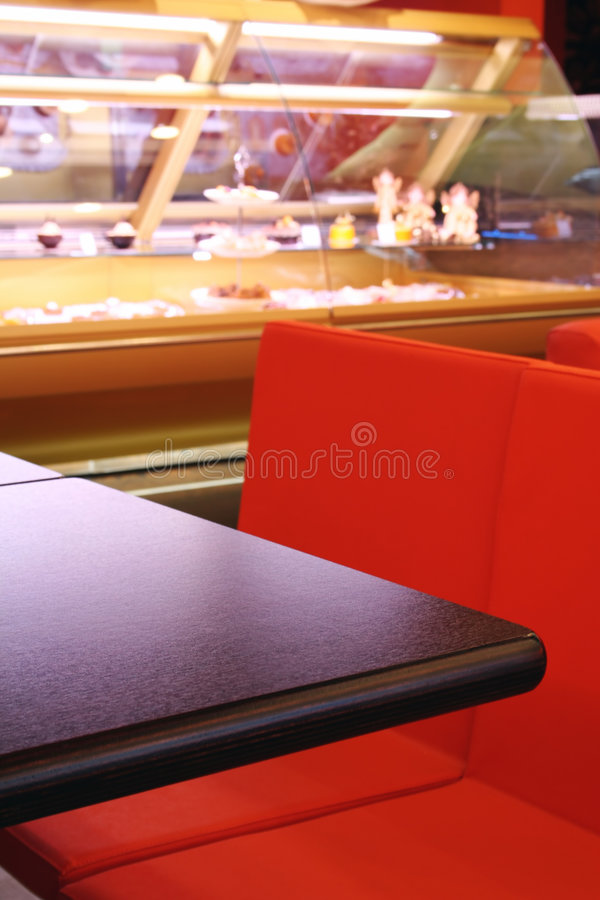 Interior cafe. In red color with wood table royalty free stock images