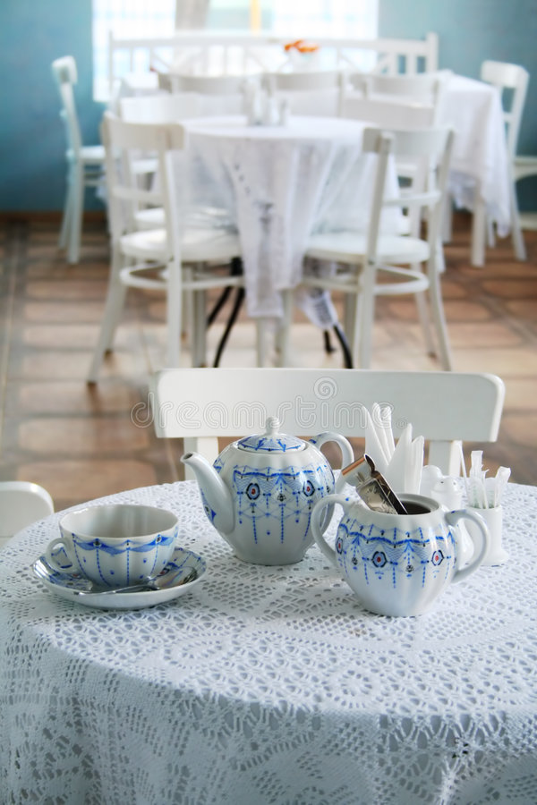 Interior cafe. With tea accessories in white and blue color stock photos