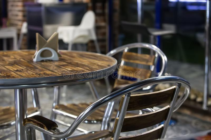 Interior cafe with metal furniture. Interior cafe with metal chairs and tables royalty free stock image