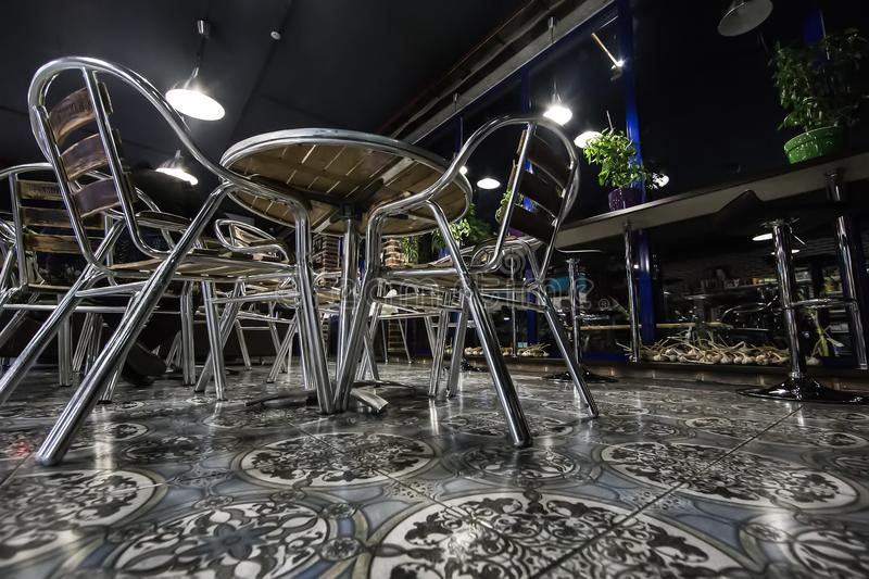 Interior cafe with metal furniture. Interior cafe with metal chairs and tables stock image