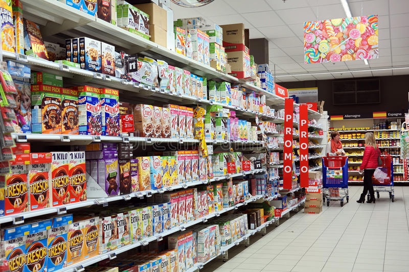 Interior of a Carrefour Hypermarket. WALLONIA, BELGIUM - JULY 2015: Shopping in the cornflakes section of a Carrefour Hypermarket stock photo