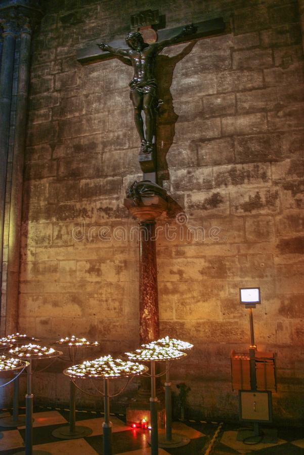 Interior of Cathedral with candles. Religious symbols in Notre Dame de Paris. Decorative elements of Cathedral stock photos