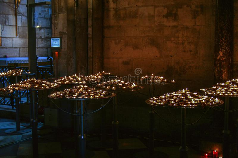Interior of Cathedral with candles. Religious symbols in Notre Dame de Paris. Decorative elements of Cathedral stock photo