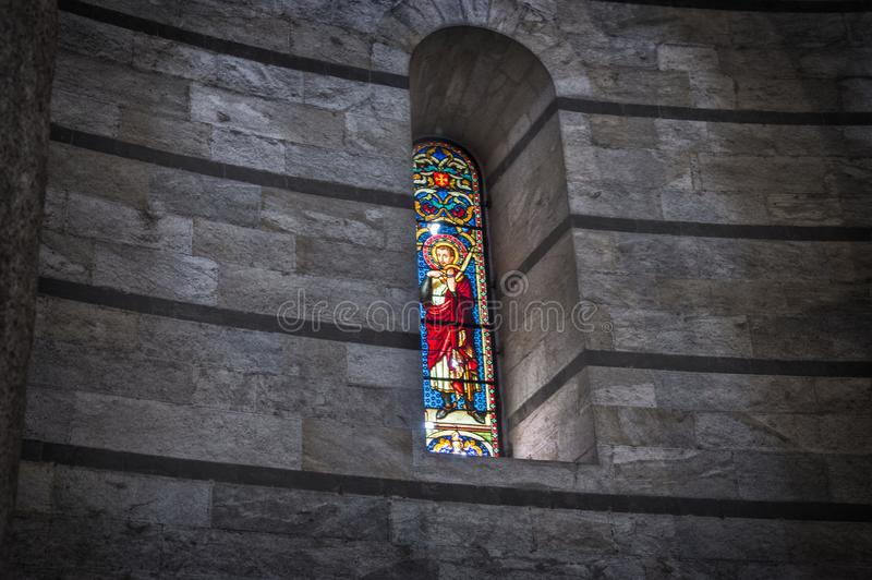 Interior of the Cathedral of Pisa. Stained glass window stock photos