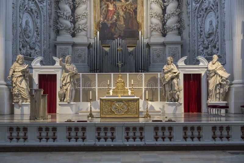 Interior of Catholic church in Munich, Germany. Rich interior of baroque period catholic church royalty free stock photo