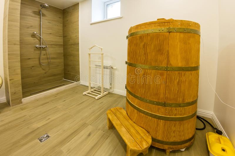 Interior cedar phyto barrel sauna with shower in the medical spa salon royalty free stock photo