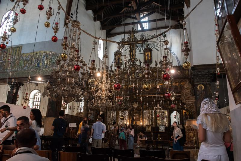 Interior of the Church of the Nativity, Bethlehem, with pilgrims stock photo