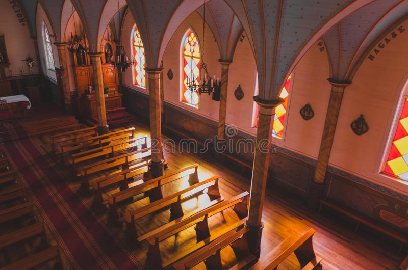 Interior of church with warm ambience light product that enters from the side royalty free stock photography