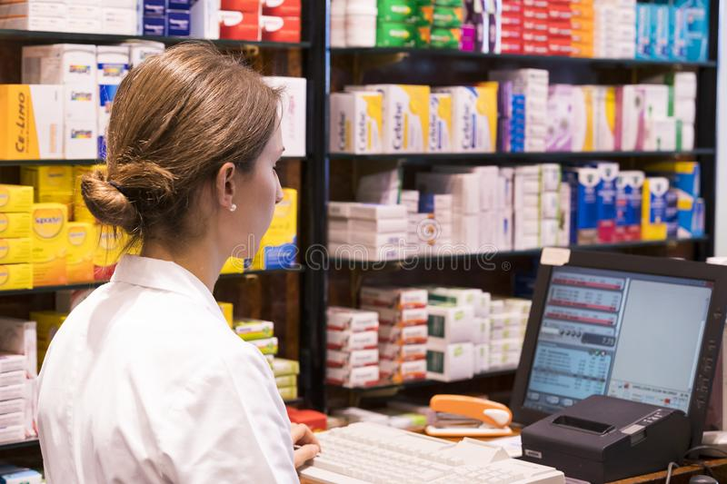 The interior of the city pharmacy in the shelves with medicines and preparations. VIENNA, AUSTRIA - 23 AUGUST 2017:The interior of the city pharmacy in the royalty free stock image
