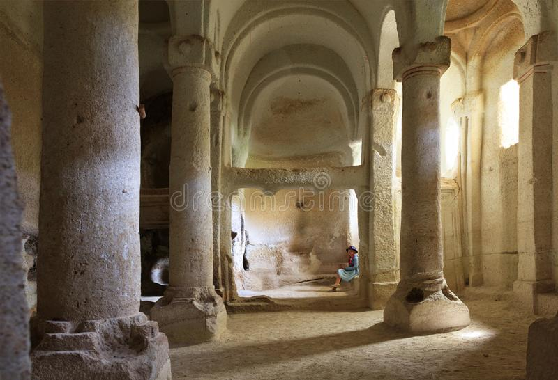 The interior of the column hall of the old underground church carved into the sandstone rock royalty free stock photo