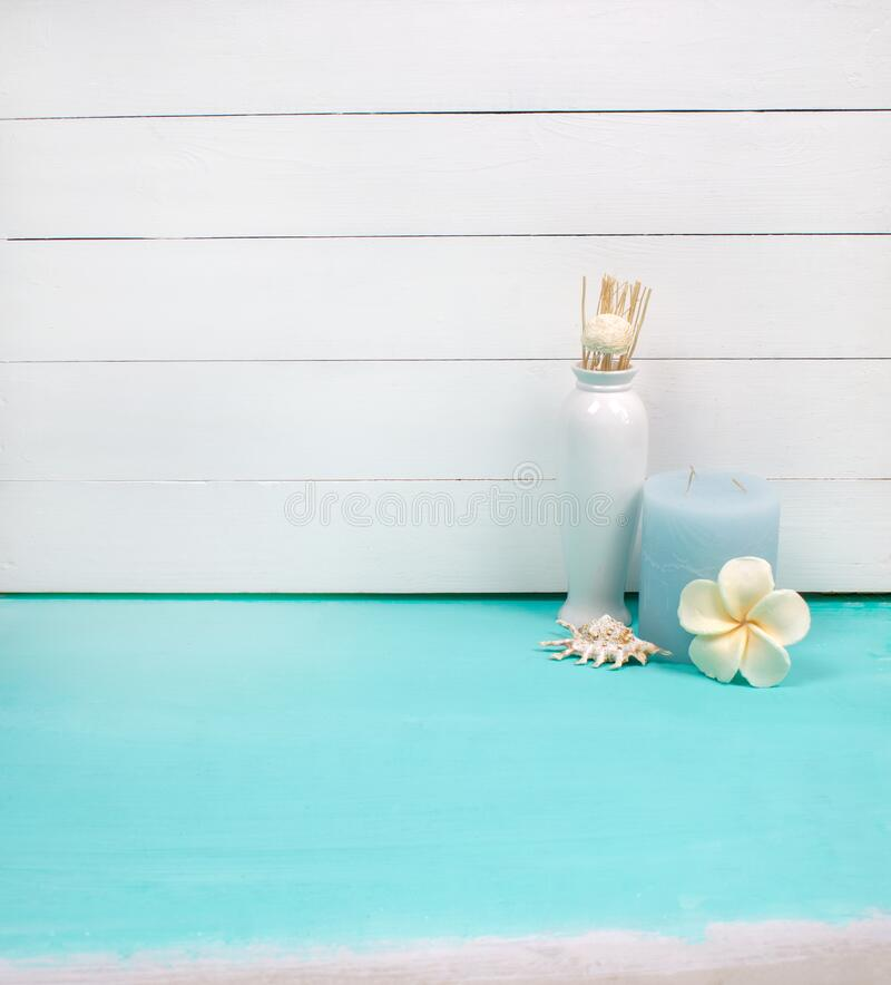 Interior composition home, flowers, candle, sea shell, soap and vase on white wood and mint background. Modern interior. Minimalis. Interior decoration of a stock photo